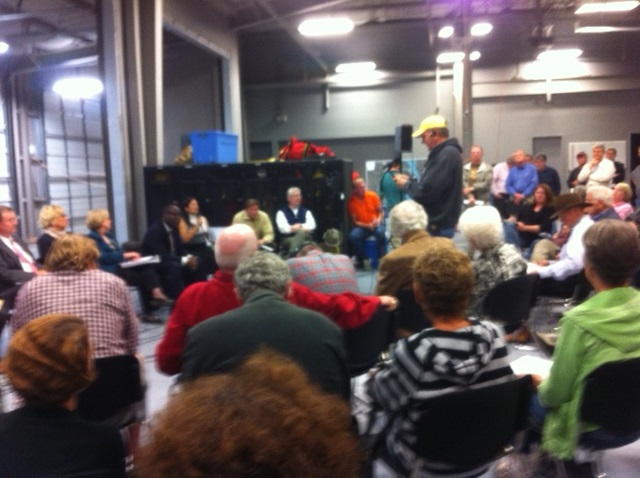 So many people attended that the meeting had to be moved to the fire truck dispatch area